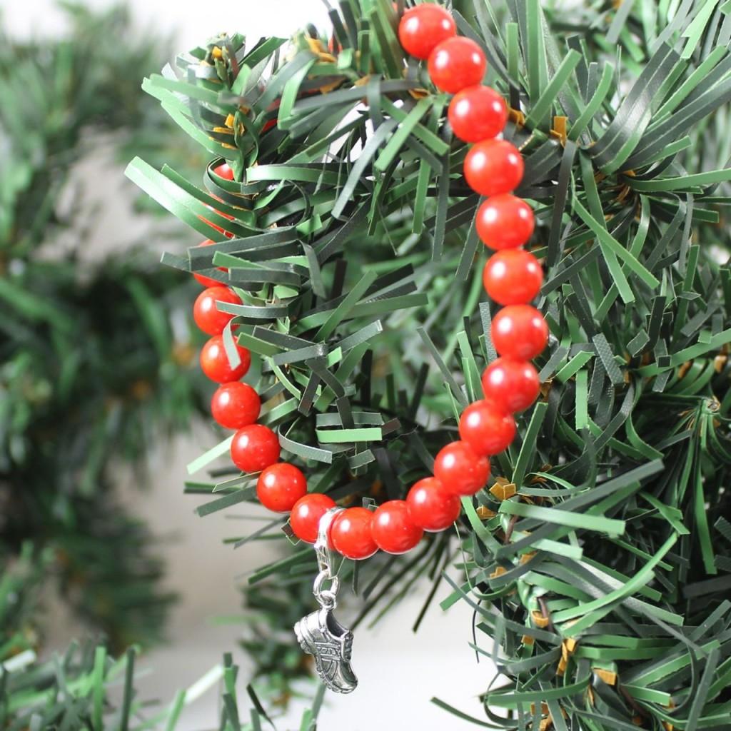 red coral bracelet on pine